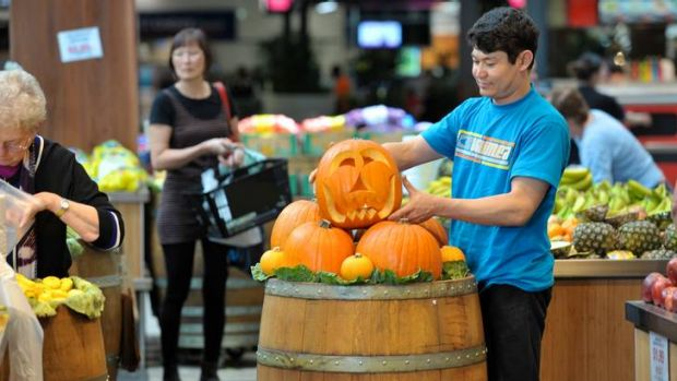 Heads will roll: Mohammad Ali Rezai sets up a pumpkin display at Fountain Gate vegetable market.