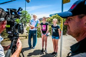 Lauren Jackson  with Isabelle Bourne (11) and Callie Bourne (13), wait for the Lauren Jackson bus in a scene for Disney ...