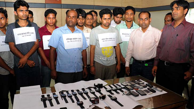 Bangladesh police parade alleged members of hi-tech exam cheats who use watch-like mobile phones to help examinees pass ...