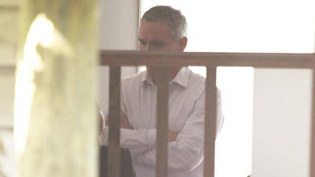 House raided ... Craig Thomson pictured in his home today.