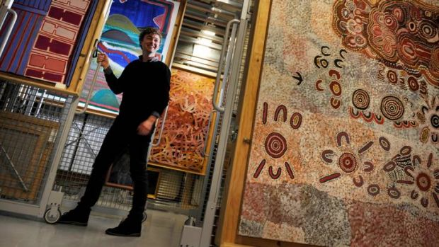 Assistant collection manager Adam Cullen in the indigenous section of National Gallery of Victoria archive.