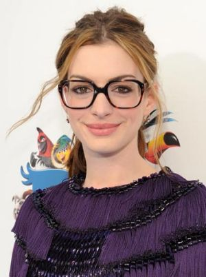 Specs appeal: Anne Hathaway is fashionably framed by her chunky glasses.