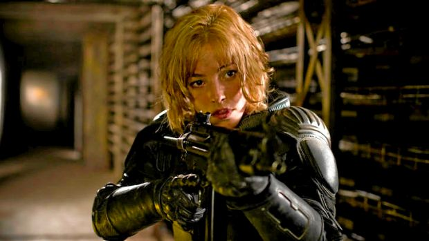 Olivia Thirlby plays things tough, not sexy, as Judge Dredd's sidekick. ''I'm not an eye-candy kind of girl.''