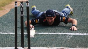 Australian formula one driver Mark Webber gets in a game of cricket ahead of the Indian Grand Prix this weekend. Webber ...