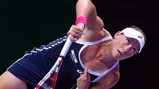 Samantha Stosur in action against Sara Errani of Italy during day three of the season-ending WTA Championships in ...