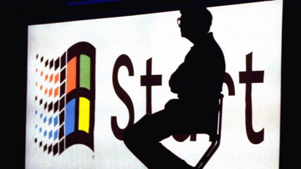 Microsoft chairman Bill Gates sits on stage during a video portion of the Windows 95 Launch Event on the company's ...