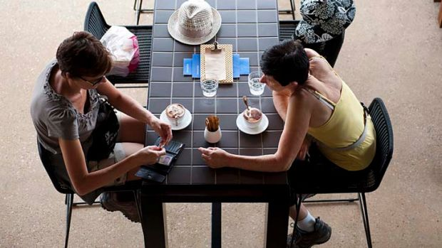 Women have a coffee at Aquitaine Brasserie.