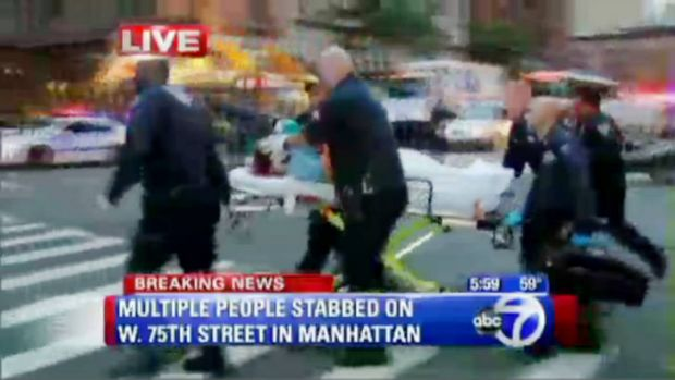 An adult victim is removed from a New York apartment where police reported a nanny stabbed two children to death. Video ...