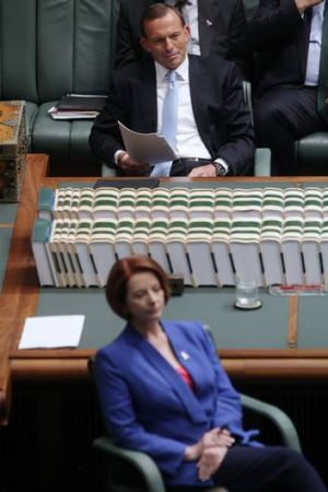 Not so out of touch . . . Tony Abbott and Julia Gillard.