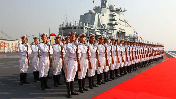 Naval power ... military officers onboard China's aircraft carrier, Liaoning.