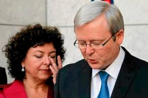 Therese Rein wipes a tear during his press conference after he renounced the prime ministership.
