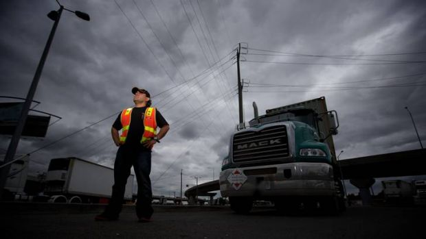 Toll worker Karael Vallecillo drives a truck in LA for $US13 an hour.