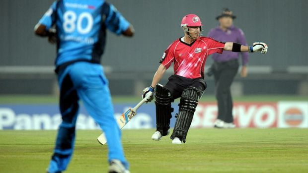 Sydney Sixers batsman Brad Haddin runs between the wickets on October 26, 2012 during a semi-final Champions League T20 ...