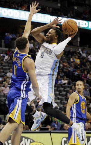 Denver Nuggets recruit Andre Iguodala in action against Golden State Warriors during the NBA pre-season.