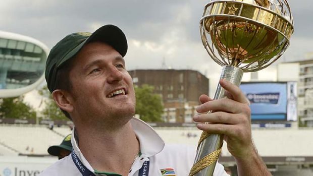 On top ... South African captain Graeme Smith holds the ICC World Test  trophy.
