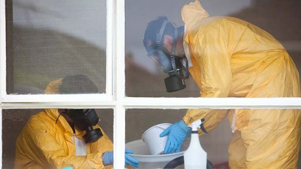 Police with breathing apparatus disassemble a drug operation at a house in Sunshine West.