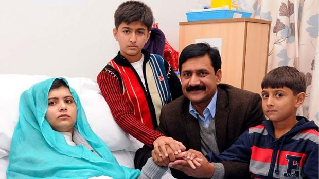Malala Yousafzai with her father, Ziauddin, and brothers, Khushal Khan and Apal Khan.