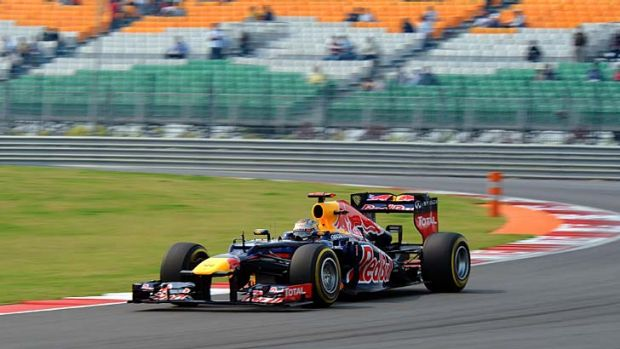 Red Bull-Renault driver Sebastian Vettel of Germany drives during the third practice session at the Buddh International ...