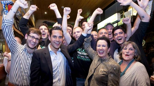 Celebration ... Alex Greenwich is congratulated by Clover Moore and other supporters after winning the Sydney byelection.