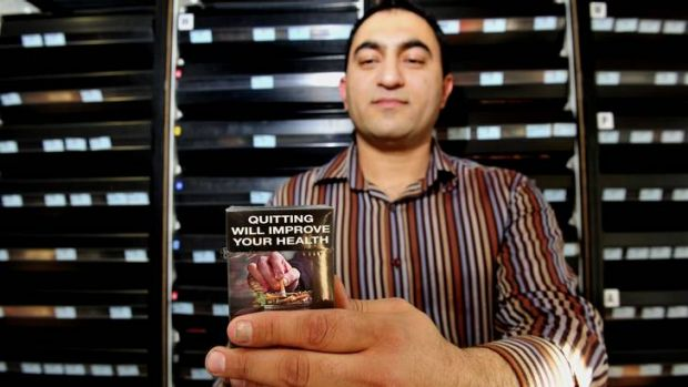 IGA Xpress Canberra City owner Abdul Osman says cigarettes in plain packaging and cigarette units are a nightmare.