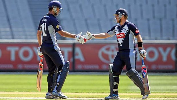 Opening batsmen Rob Quiney, left, and Aaron Finch shake hands after reaching their century partnership.