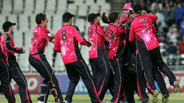 Victory ... Sydney Sixers's players celebrate after winning the final of the Champions League.