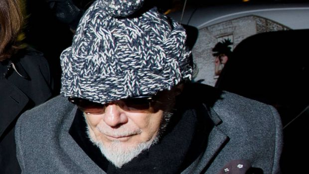 Questions ... Gary Glitter returns home in central London on Sunday  after he was arrested earlier in the day by British ...