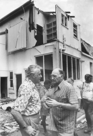 Major-General Alan Stretton, while the head of the Natural Disaster Organisation (right), makes a point to Prime ...