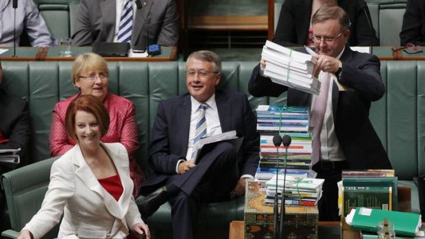 Prime Minister Julia Gillard faced down foes on both sides of the chamber after a broadside from Kevin Rudd fuelled Tony ...