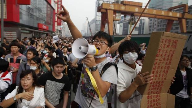 Reds versus greens … leaders of the protest in Ningbo against the expansion of a petrochemical plant ask ...