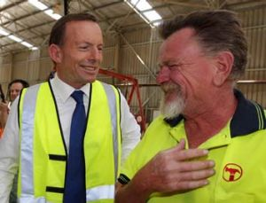 Strapped in … Tony Abbott visits a trussing factory.