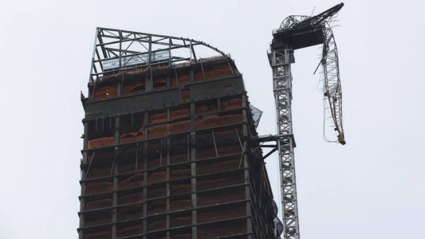 It's going to get rough ... a construction crane dangles precariously over a street in New York.