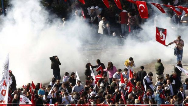 Police use tear gas to disperse the demonstrators.