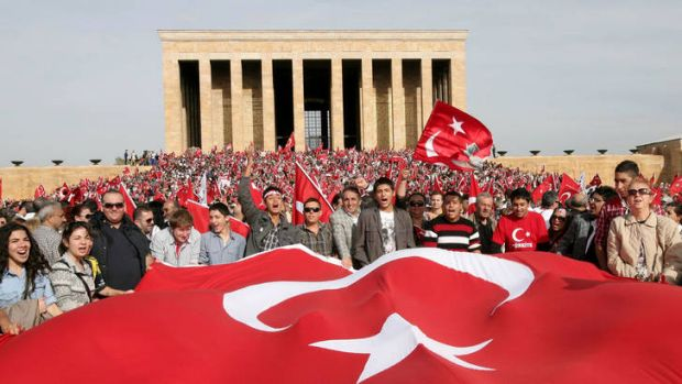 Thousands of people holding national flags gather at the Ataturk mausoleum to celebrate Republic Day and demand the ...