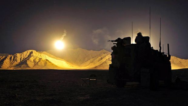 An Afghan Artillery illumination round lights an Australian position in the West Dorafshan region of Uruzgan province in ...