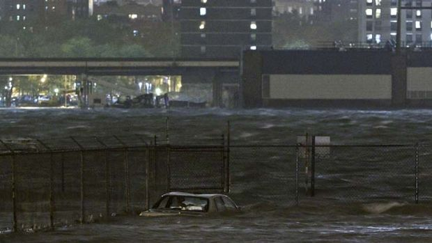 Burst its banks ... the East River overflows as Sandy sweeps through New York.