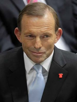 Itching at his tax hair shirt ... Opposition Leader Tony Abbott.