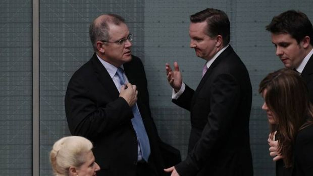 Shadow Immigration Minister Scott Morrison speaks with Immigration Minister Chris Bowen at the end of Question Time at ...
