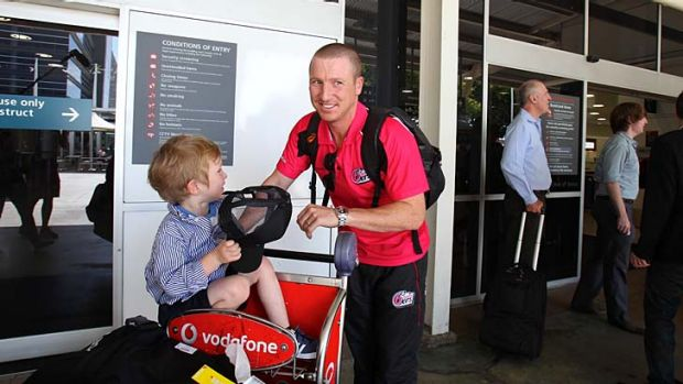 Brad Haddin with his son Zac after returning to Sydney on Tuesday.