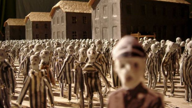 Thousands of three-inch-high puppets represent prisoners in the Auschwitz-Birkenau concentration camp in <i>Kamp</i> by ...