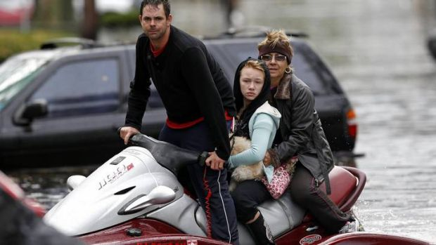 A resident assists in rescue efforts with his jet-ski in New Jersey.