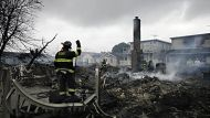 A fire fighter surveys the smoldering ruins of a house in the Breezy Point section of New York, Tuesday, Oct. 30, 2012. ...