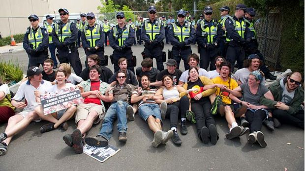 Protesters stage a sit-in in front of the Maribyrnong detention centre.