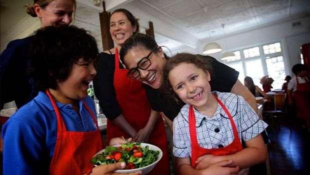 Being served ... Kylie Kwong, centre, with Bondi Public students Elio Forte, left, and Estella Heifetz.