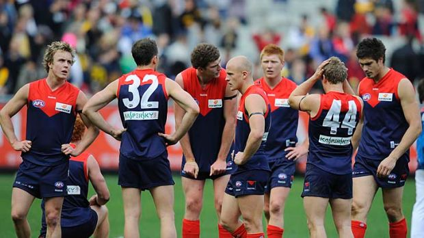 Under pressure: Demons players after the 2009 defeat against Richmond.