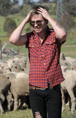 Reece Mastin, winner of the 2011 series of X Factor Australia, tries his hand at sheep farming at Gold Creek Station in ...