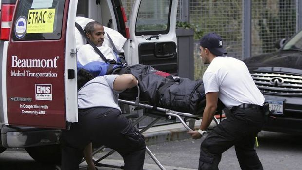Evacuation ... paramedics wheel a patient out of Bellevue Hospital.