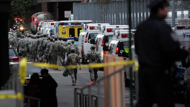 Military personnel help with the evacuation of Bellevue Hospital.