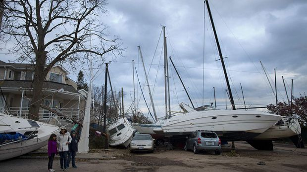 Hit hard ... a boat is dumped on top of cars on Staten Island, which was smashed by huge storm surge.