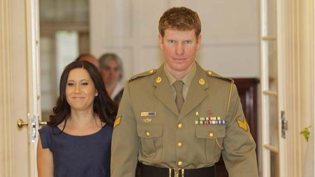 Corporal Daniel Keighran, with his wife Kathryn, has been presented the Victoria Cross medal.